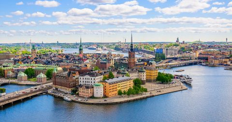 Aerial panorama from height of bird's flight on observation deck on tower City Hall to Gamla Stan (Old Town), Stockholm, Sweden; Shutterstock ID 613199033